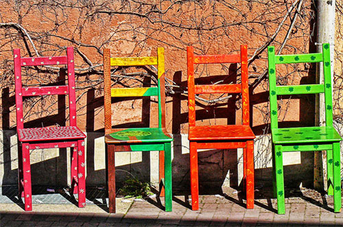 Four colored chairs detail by Daniel Schwabe
