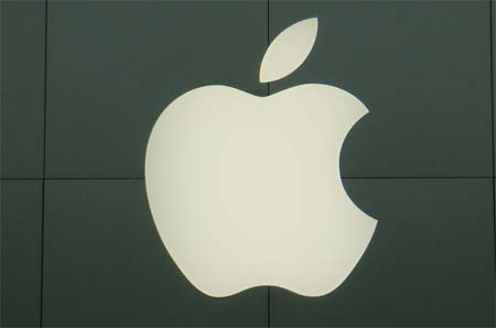 White apple logo hanged on a wall.