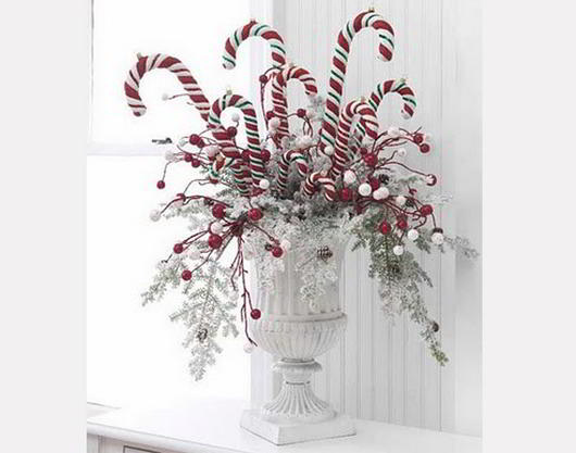 Candy canes in white urn