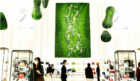 Thousands of leaves cover the walls of Isetan Department Store for their grand opening